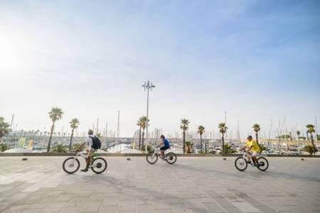 Barcelona: E-Bike Tour With Cable Car, Boat Trip & Skip-The-Line Tickets To Sagrada Familia
