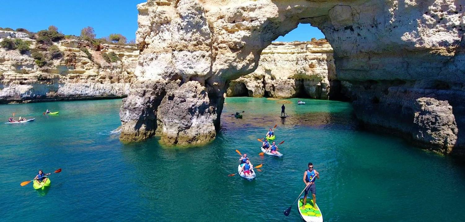 This is a guided kayak and SUP tour that starts in Albufeira, taking you to Benagil on a catamaran.