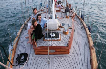 True Sunset Sailing In Wooden Boat In Barcelona