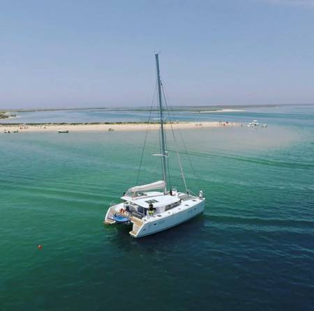 From Faro: Full-Day Private Trip On Sailing Catamaran Around The Islands Of Ria Formosa