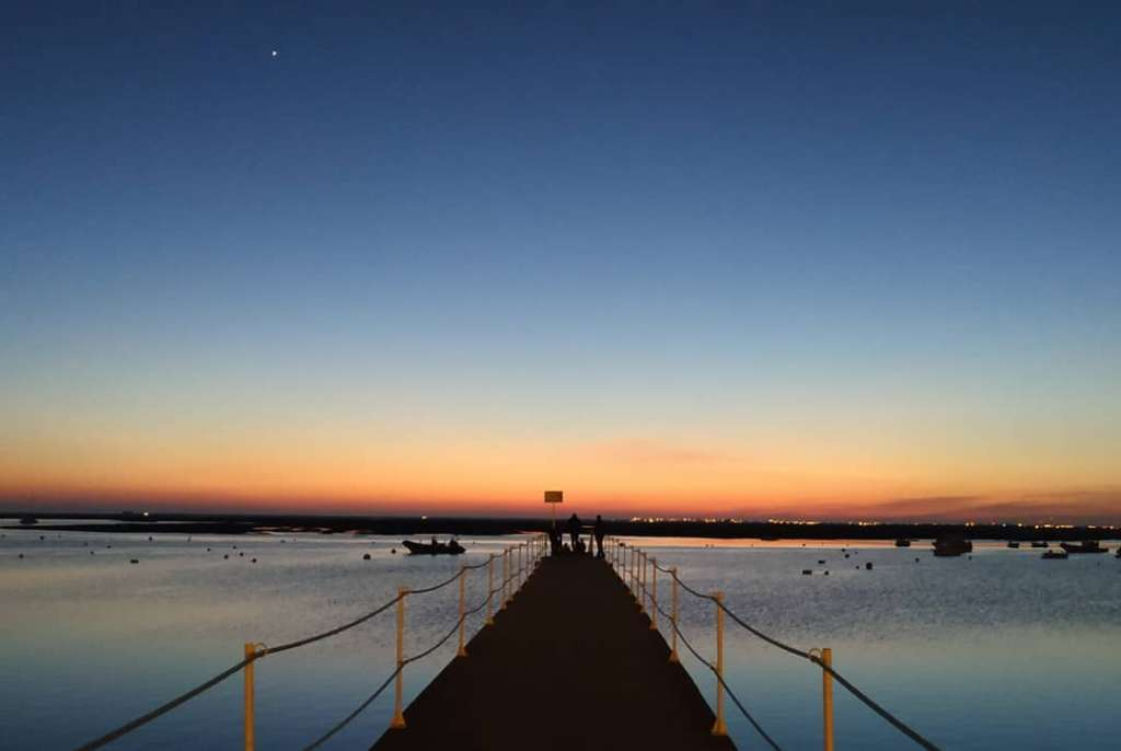sunset on the ria formosa pier in faro